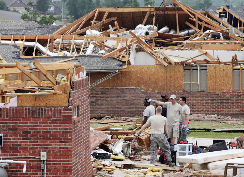 Photo - Tornado damage south of I-40 and Choctaw Road in the Deerfield Estates housing addition in Oklahoma City, Tuesday, May 11, 2010. Photo by Jim Beckel, The Oklahoman.