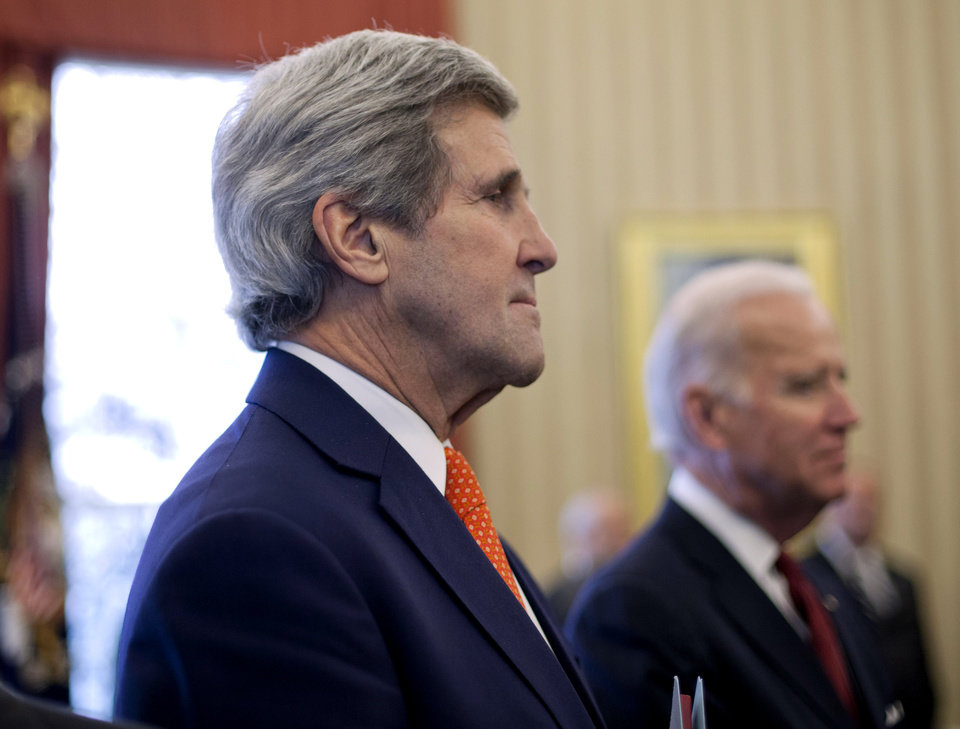 Photo - Secretary of State John Kerry, left, and Vice President Joe Biden listen to President Barack Obama answers a question regarding the ongoing situation in the Ukraine, during his meeting with Israeli Prime Minister Benjamin Netanyahu, Monday, March 3, 2014, in the Oval Office of the White House in Washington. Kerry will travel to the Ukrainian capital of Kiev tomorrow to meet with government officials and comes as the U.S. and other Western nations weigh a response to Russia's military advance into Ukraine. (AP Photo/Pablo Martinez Monsivais)