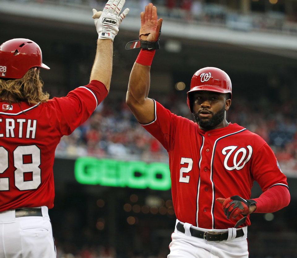 Photo - Washington Nationals' Denard Span (2) celebrates scoring with Jayson Werth (28) during the first inning of a baseball game against the Philadelphia Phillies at Nationals Park, Saturday, Aug. 2, 2014, in Washington. (AP Photo/Alex Brandon)