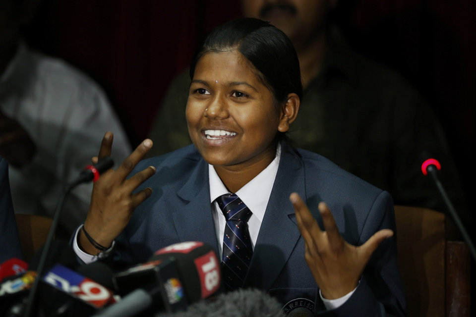 Photo - Malavath Poorna, from the southern Indian state of Andhra Pradesh addresses a press conference in New Delhi, India, Wednesday, June 4, 2014. A social charity says the 13-year-old daughter of poor Indian farmers has become the youngest girl to climb Mount Everest. Poorna says she and a team of Nepalese climbing guides made it to the top on May 25 from the northern side in Tibet. (AP Photo/Saurabh Das)