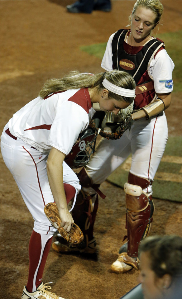 Photo - Oklahoma's Kelsey Stevens scrapes dirt from her shoes as the University of Oklahoma Sooner (OU) softball team plays Tennessee in the first game of the NCAA super regional at Marita Hynes Field on May 23, 2014 in Norman, Okla. Photo by Steve Sisney, The Oklahoman
