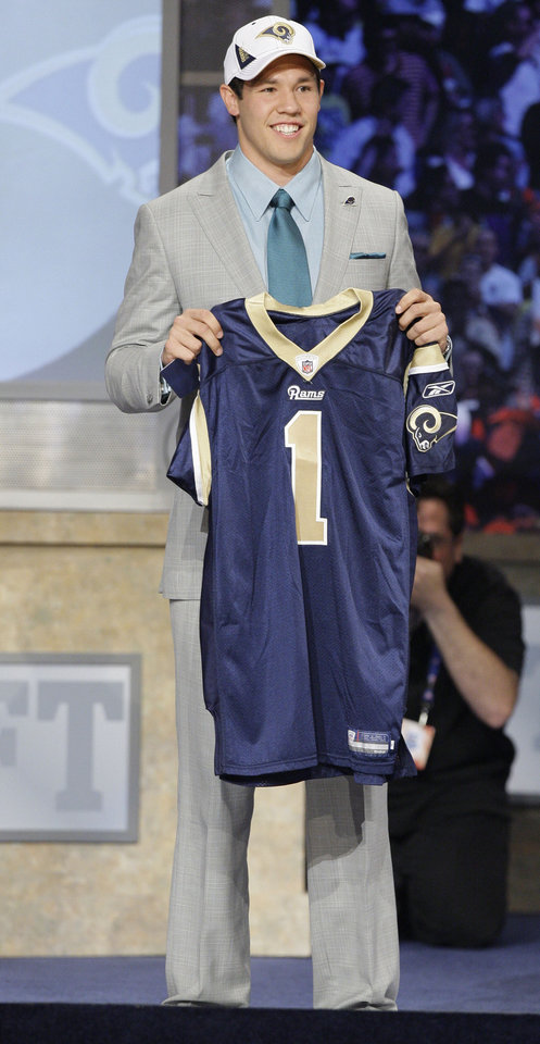 Photo - Oklahoma quarterback Sam Bradford smiles after he was selected as the No. 1 overall pick by the St. Louis Rams in the first round of the NFL Draft at Radio City Music Hall, Thursday, April 22, 2010, in New York.  (AP Photo/Frank Franklin II)