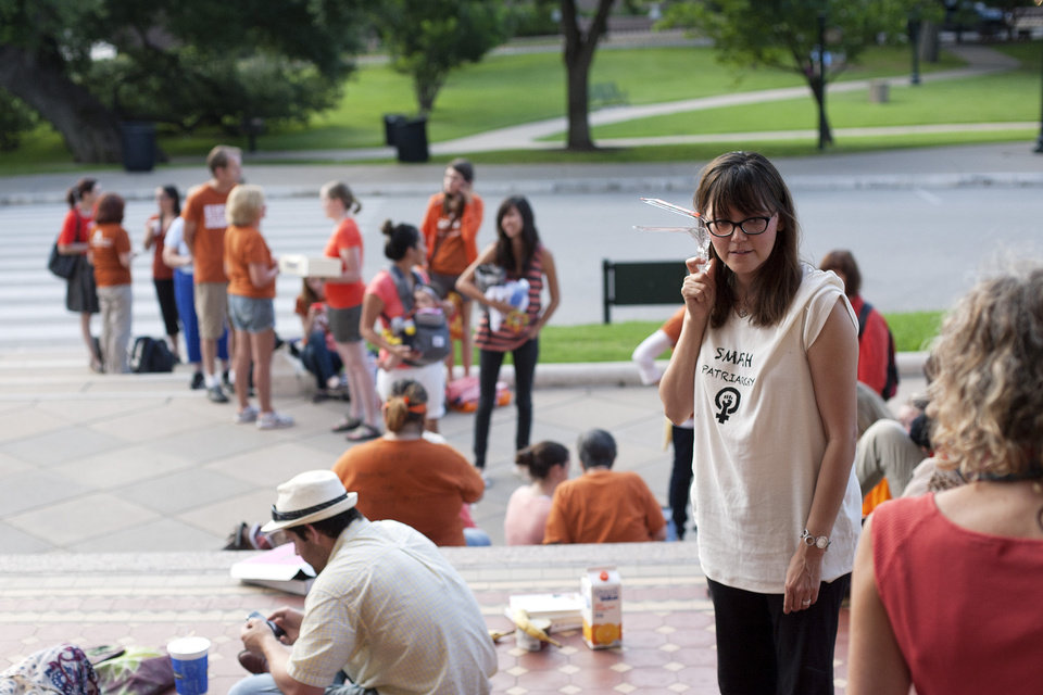 Kristi Lara holds a gynecological speculum as she and dozens of others wait for the Texas State Capitol to open its doors at 7 a.m., in Austin, Texas, Friday, July 12, 2013. Many demonstrators brought gynecological devices to the Capitol to symbolically personalize women\'s issues. The Texas Senate\'s leader, Lt. Gov. David Dewhurst, has scheduled a vote for Friday on the same restrictions on when, where and how women may obtain abortions in Texas that failed to become law after a Democratic filibuster and raucous protesters were able to run out the clock on an earlier special session. (AP Photo/Tamir Kalifa)