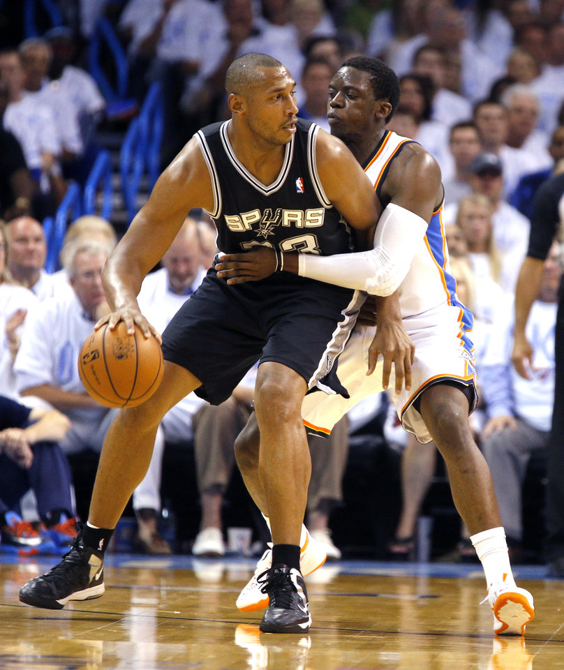 Photo - Oklahoma City's Reggie Jackson (15) defends against San Antonio's Boris Diaw (33) during Game 6 of the Western Conference Finals in the NBA playoffs between the Oklahoma City Thunder and the San Antonio Spurs at Chesapeake Energy Arena in Oklahoma City, Saturday, May 31, 2014. Photo by Bryan Terry, The Oklahoman