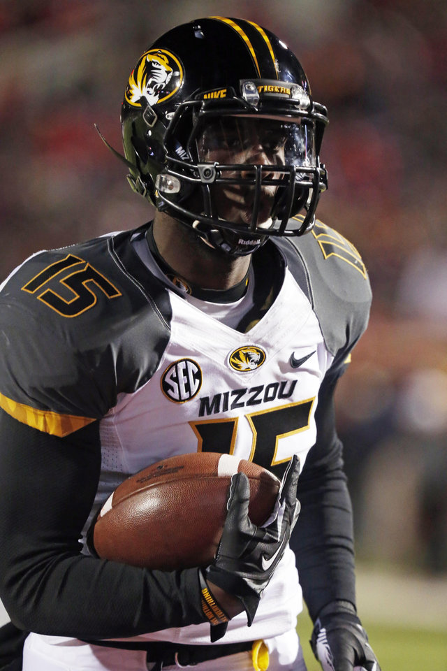 Photo - FILE - In this Nov. 23, 2013, file photo, Missouri wide receiver Dorial Green-Beckham runs with a caught pass during pre-game drills before an NCAA college football game against Mississippi in Oxford, Miss. Dorial Green-Beckham was suspended indefinitely Monday, April 7, 2014, for an unspecified violation of team rules, three months after he and two friends were arrested on suspicion of felony drug distribution when police found a pound of marijuana in their car. Coach Gary Pinkel announced the suspension without mentioning the January incident in which the standout receiver was arrested in his Missouri hometown of Springfield. (AP Photo/Rogelio V. Solis, File)