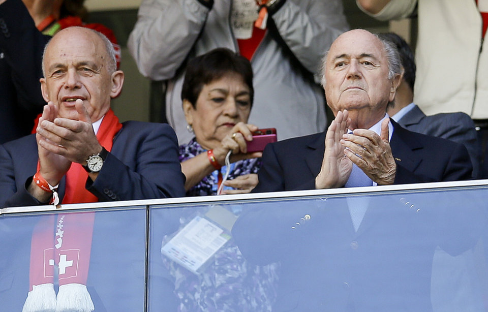Photo - FIFA President Sepp Blatter, right, applauds before the start of the group E World Cup soccer match between Switzerland and Ecuador at the Estadio Nacional in Brasilia, Brazil, Sunday, June 15, 2014. (AP Photo/Michael Sohn)