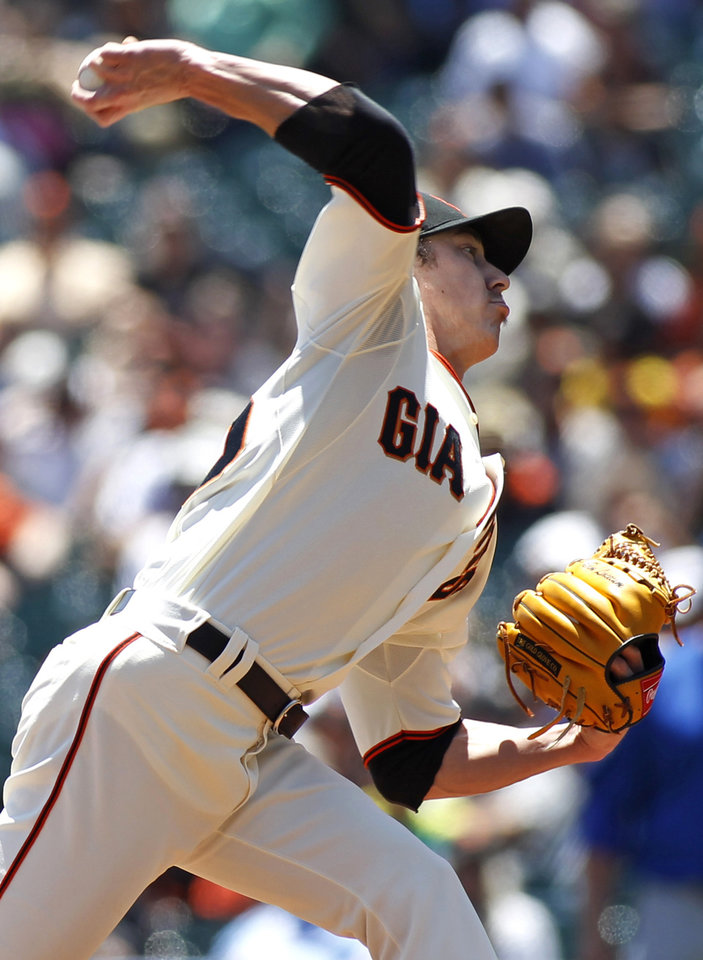 Photo - San Francisco pitcher Tim Lincecum throws to the Chicago Cubs during the first inning of a baseball game, Wednesday, May 28, 2014, in San Francisco. (AP Photo/George Nikitin)