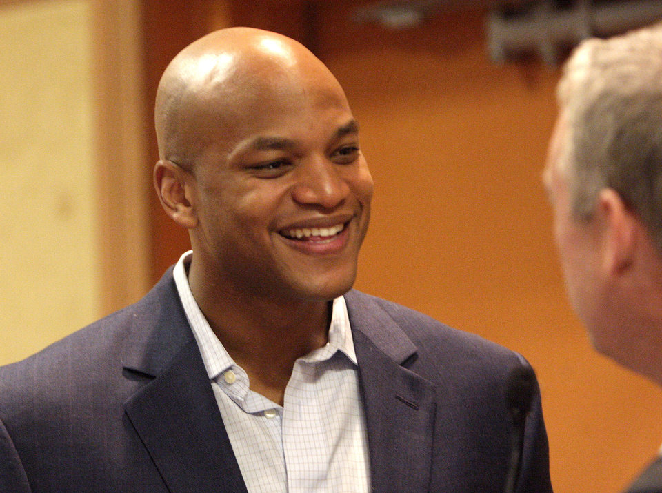Photo - Author and youth advocate Wes Moore talks during a reception held before the Whiz Kids' Seeds of Hope charity event on Tuesday at the Cox Convention Center.    SARAH PHIPPS - SARAH PHIPPS