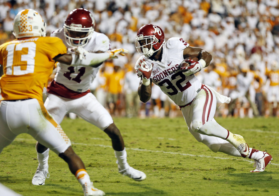 Photo - Oklahoma's Samaje Perine (32) carries the ball as Dede Westbrook (11) blocks Tennessee's Malik Foreman (13) during the college football game between the Oklahoma Sooners (OU) and the Tennessee Volunteers at Neyland Stadium in Knoxville, Tennessee, Saturday, Sept. 12, 2015. OU won 31-24 in double overtime. Photo by Nate Billings, The Oklahoman
