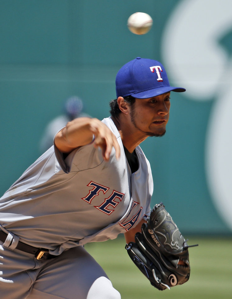 Photo - Texas Rangers starting pitcher Yu Darvish (11) throws during the second inning of a baseball game against the Washington Nationals at Nationals Park, Sunday, June 1, 2014, in Washington. (AP Photo/Alex Brandon)