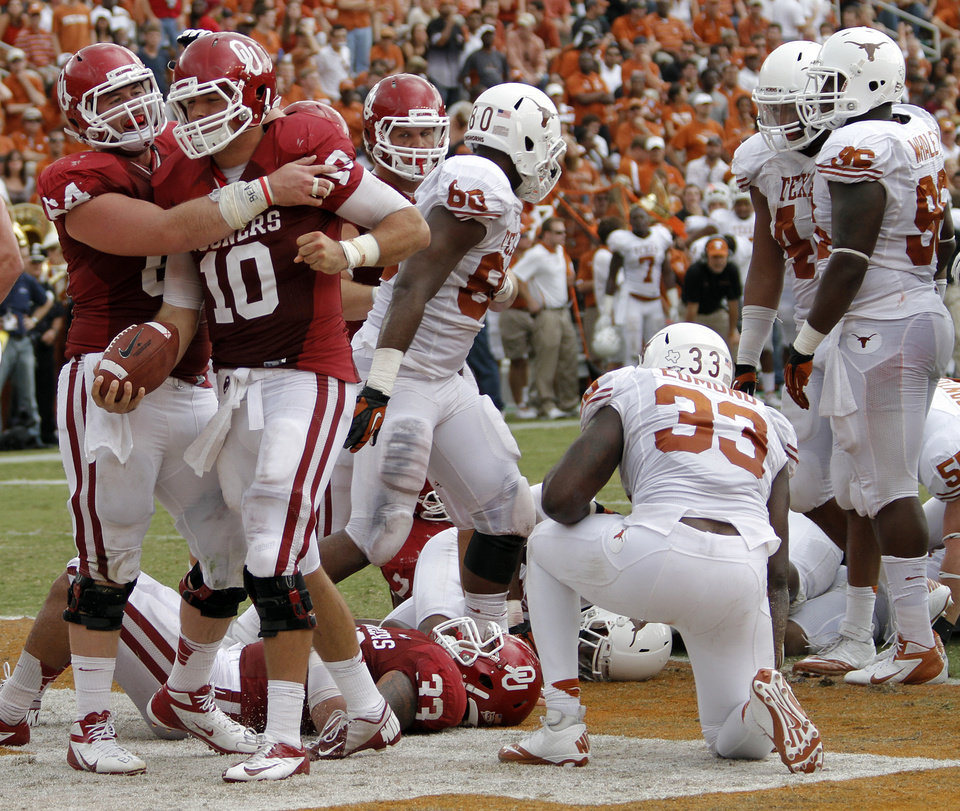OU\'s Gabe Ikard (64) celebrates a touchdown with Blake Bell (10) during the Red River Rivalry college football game between the University of Oklahoma (OU) and the University of Texas (UT) at the Cotton Bowl in Dallas, Saturday, Oct. 13, 2012. Photo by Chris Landsberger, The Oklahoman