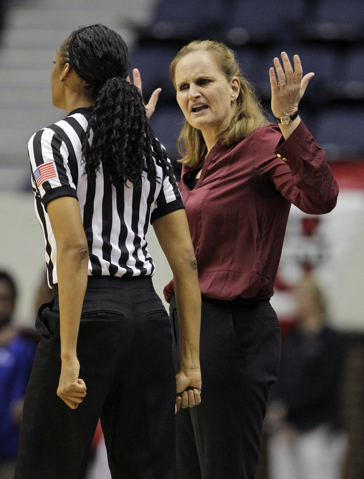Photo - Fordham head coach Stephanie Gaitley, right, disputes a call during the first half of the Atlantic 10 Conference college basketball championship game against Dayton in Richmond, Va., Sunday, March 9, 2014. (AP Photo/Steve Helber)