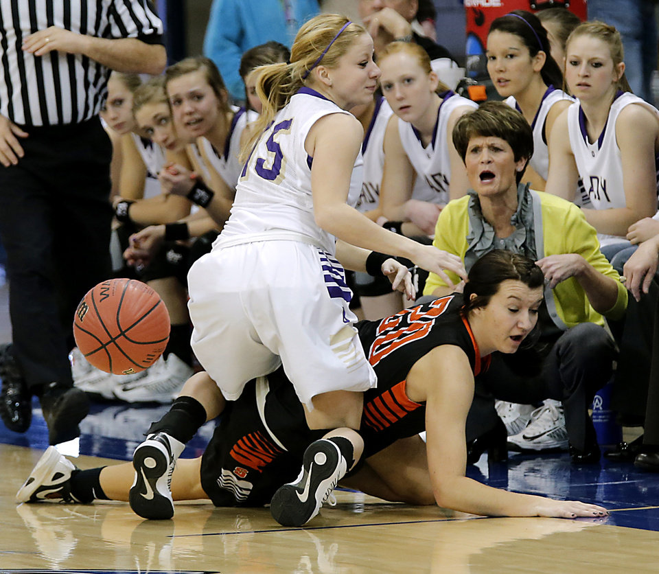 Photo - Okarche's Madi Grellner (15) Sterling's Shelbi Smith (20) battle for the loose ball during the Class A girls state quarterfinal game between Okarche and Sterling at Oklahoma City University on Thursday, Feb. 28, 2013, in Oklahoma City, Okla. Photo by Chris Landsberger, The Oklahoman