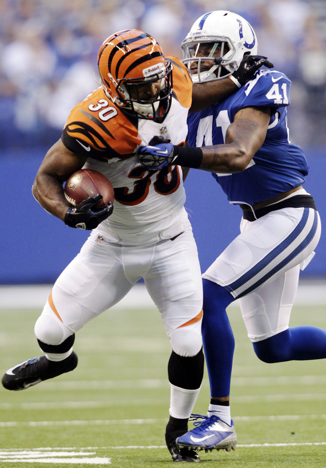 Photo -   Cincinnati Bengals running back Cedric Peerman (30) is tackled by Indianapolis Colts defensive back Antoine Bethea in the first half of an NFL preseason football game in Indianapolis, Thursday, Aug. 30, 2012. (AP Photo/AJ Mast)