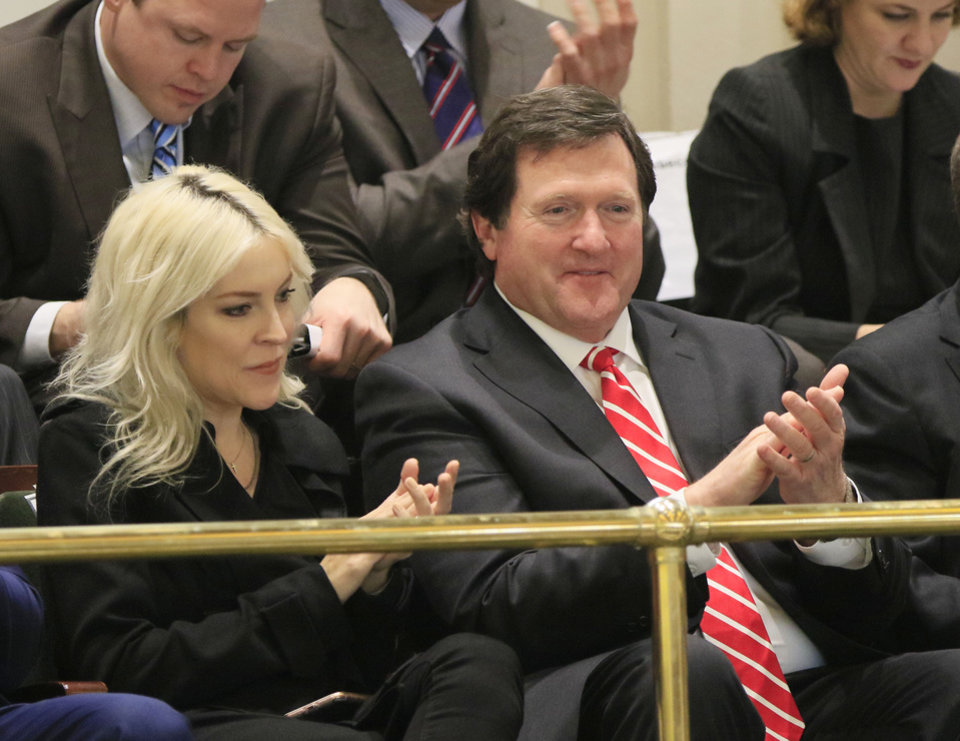 Photo - Daughter Christina Fallin and First Gentleman Wade Christensen listen as Governor Mary Fallin delivers the State of the State address on the floor of the House of Representatives at the State Capitol in Oklahoma City, Okla. Monday, Feb. 6, 2017.  Photo by Paul Hellstern, The Oklahoman