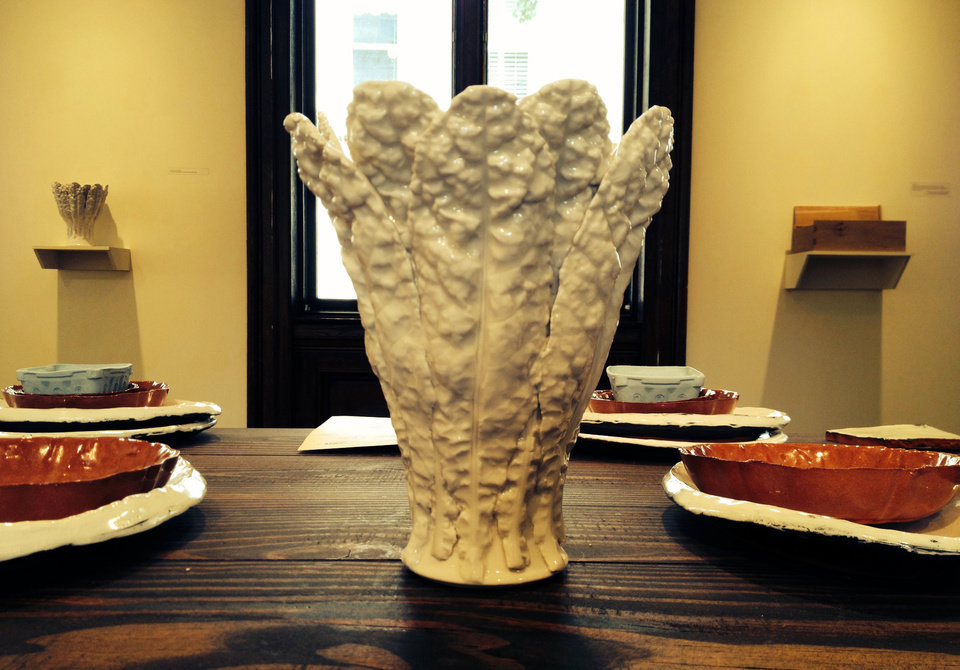 "Photo - This 2014 photo shows a vase on display at the Philadelphia Art Alliance, created by artist Gregg Moore and part of a show called ""Heirloom,"" in Philadelphia. Moore's fine ceramic pottery is used in a seven-course, $150 dinner served at the museum and created by chef Pierre Calmels, called ""Table d'Hote."" Moore says the art _ part of a movement called social practice art _ is created by the experience of the food, ceramics, museum space and people sharing the meal. (AP Photo/Eileen Glanton)"