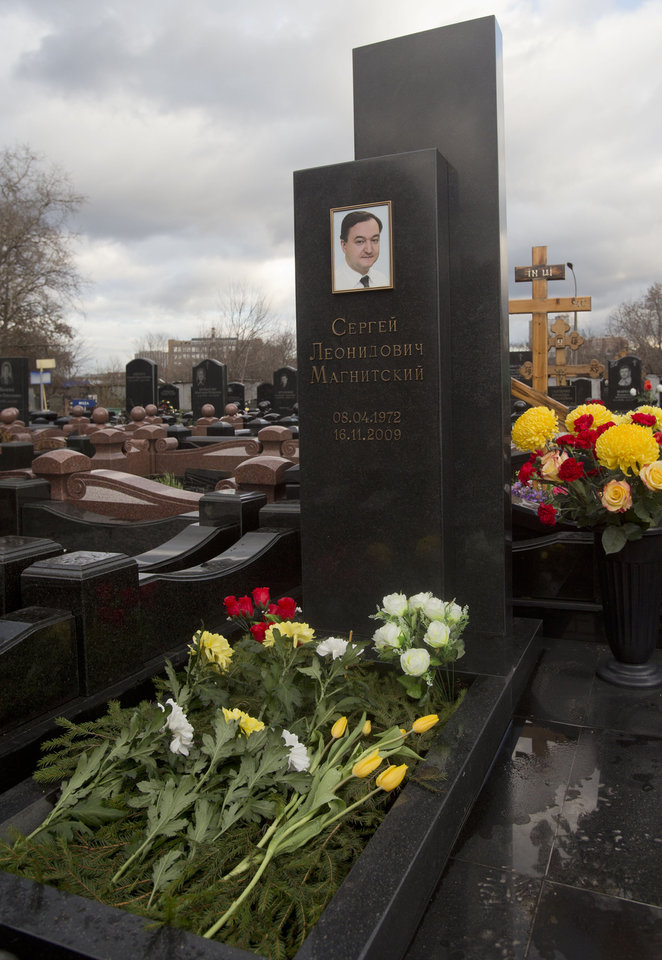 Photo -   A tombstone on the grave of lawyer Sergei Magnitsky who died in jail, at a cemetery in Moscow, Friday, Nov. 16, 2012. U.S. lawmakers are expected to vote in a human rights legislation named after Magnitsky that would impose sanctions on Russian officials involved in human rights violations. (AP Photo/Misha Japaridze)
