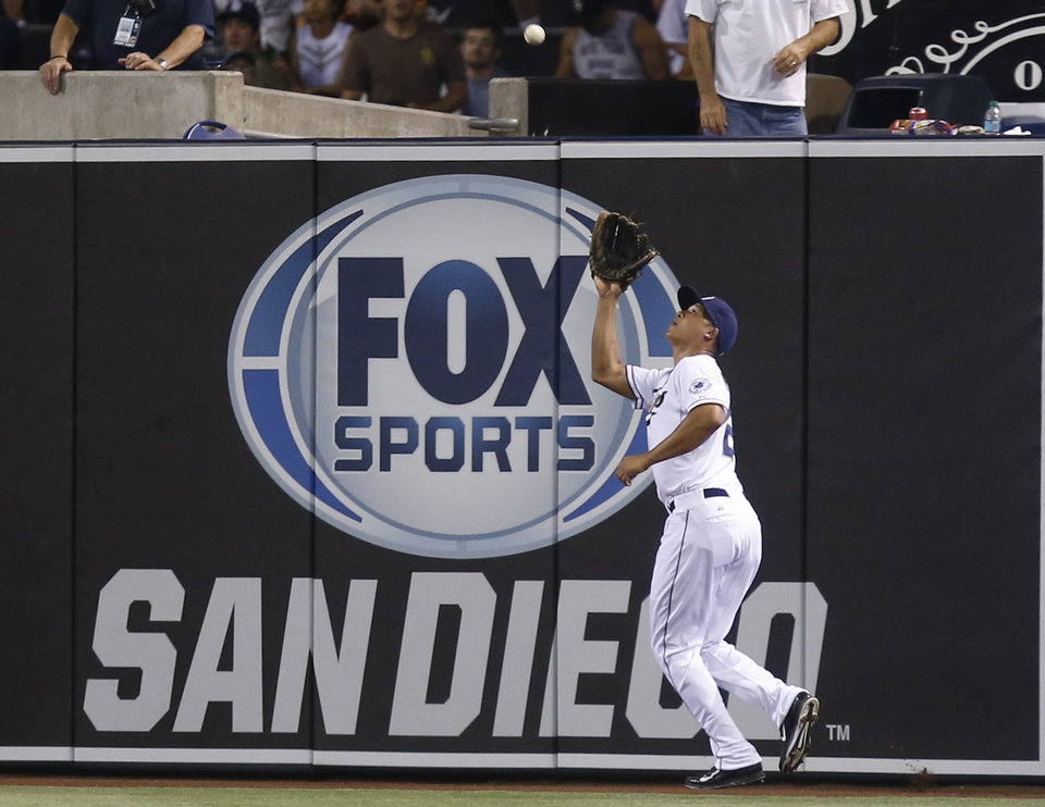 Photo - San Diego Padres right fielder Will Venable goes to fence to haul in a deep drive by St. Louis Cardinals' Matt Adams with two runners on base in the third inning of a baseball game Tuesday, July 29, 2014, in San Diego.  (AP Photo/Lenny Ignelzi)