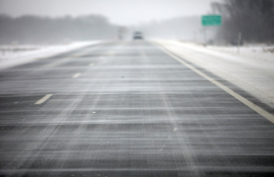 Photo - Snow blows across south bound US Route 131 in Kalamazoo, Mich. on Thursday, Jan. 2, 2014. A multi-day storm dropped up to a foot of snow on parts of Michigan, causing crashes and spinouts on roadways. Snowfall began Tuesday and continued Thursday morning. (AP Photo/Kalamazoo Gazette-MLive Media Group, Mark Bugnaski) ALL LOCAL TV OUT; LOCAL TV INTERNET OUT
