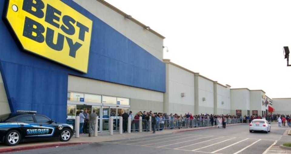 Photo -  Shoppers wait in line at Best Buy on N May Avenue on Thanksgiving Day, 2017. The company announced this week it was furloughing 51,000 employees. [BY M. TIM BLAKE/FOR THE OKLAHOMAN]