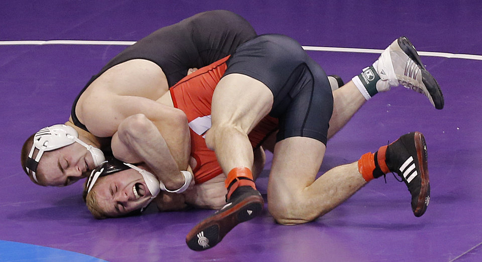 Photo - Oklahoma State's Chris Perry, back, takes on Wisconsin's Scott Liegel in the 174 pound match during the 2014 NCAA Div. 1 Wrestling Championships at Chesapeake Energy Arena in Oklahoma City, Okla. on Thursday, March 20, 2014. Photo by Chris Landsberger, The Oklahoman