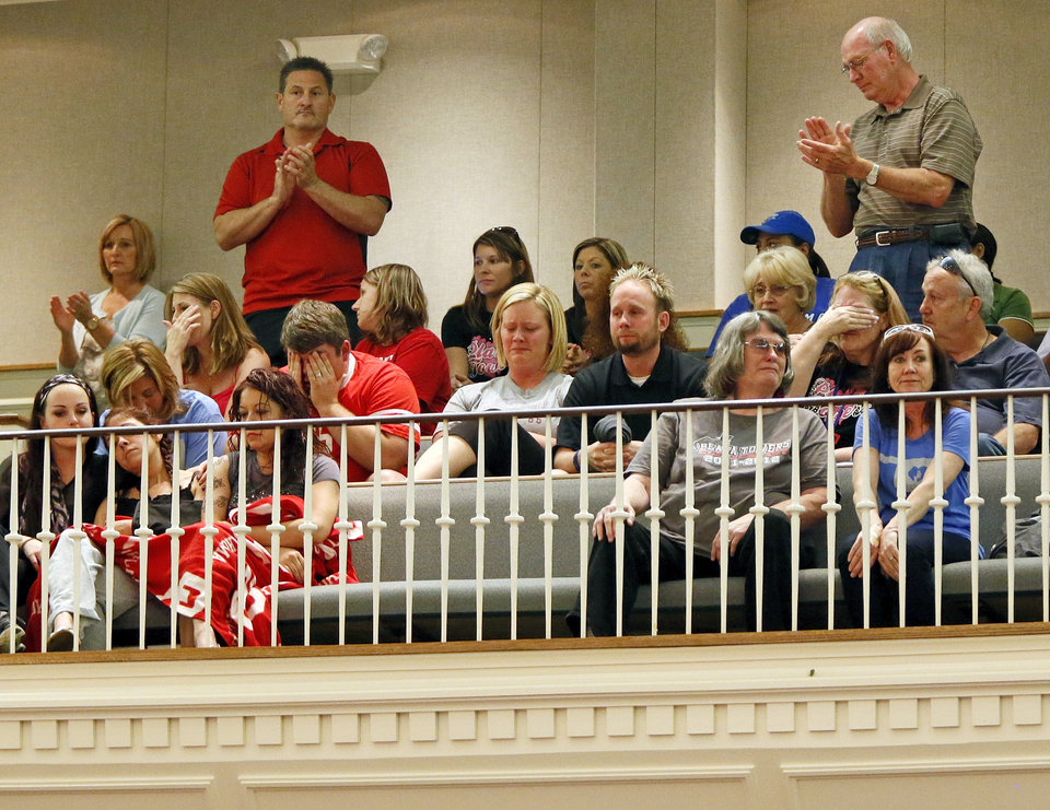Photo - Plaza Towers Elementary staff members sit in the balcony as they receive a standing ovation during a district-wide meeting of Moore Public Schools employees at Southern Hills Baptist Church, 8601 Pennsylvania Ave., in Oklahoma City, Wednesday, May 22, 2013. Seven children were killed and the school was destroyed when a tornado struck south Oklahoma City and Moore on Monday. Photo by Nate Billings, The Oklahoman