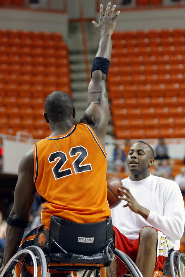 The Spokes' Jason Walley (22) attempts to block a shot by OSU's James Anderson during the wheelchair basketball charity game at Gallagher-Iba area in Stillwater, Okla., on Tuesday, April 14, 2009. BY BRENDA O'BRIAN, THE OKLAHOMAN