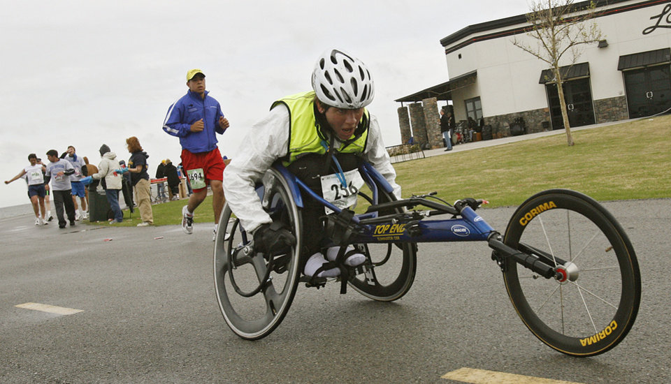 Wheelchair marathon participant goes past the water station at Lake Hefner during the eighth annual Oklahoma City Memorial Marathon on Sunday , April 27, 2008, in Oklahoma City, Okla.   PHOTO BY CHRIS LANDSBERGER   ORG XMIT: KOD