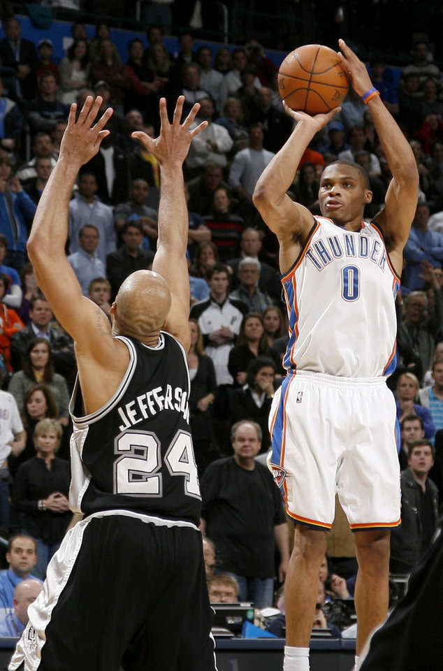 Oklahoma City's Russell Westbrook misses the last shot over San Antonio's Richard Jefferson during the NBA basketball game between the Oklahoma City Thunder and the San Antonio Spurs at the Ford Center in Oklahoma City, Wednesday, January 13, 2010. Photo by Bryan Terry, The Oklahoman