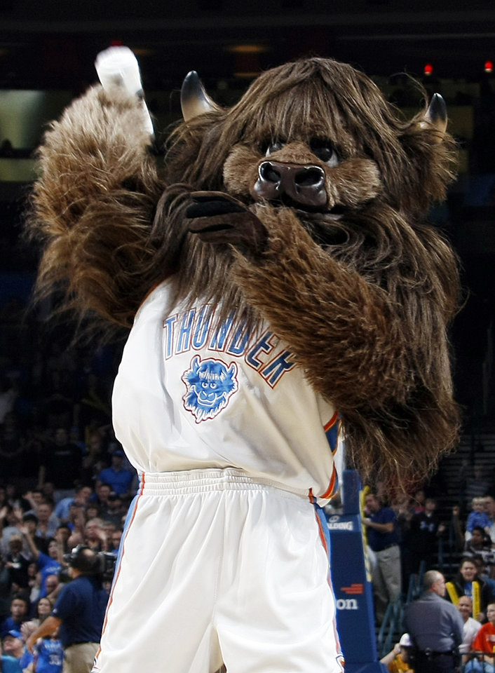 Photo - Thunder mascot Rumble the Bison tosses a t-shirt into the crowd during the NBA basketball game between the Minnesota Timberwolves and the Oklahoma City Thunder at the Oklahoma City Arena, Monday, November 22, 2010, in Oklahoma City. Photo by Nate Billings, The Oklahoman
