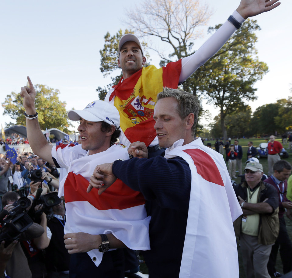 Photo - Europe's Rory McIlroy, Sergio Garcia and Luke Donald celebrate after winning the Ryder Cup PGA golf tournament Sunday, Sept. 30, 2012, at the Medinah Country Club in Medinah, Ill. (AP Photo/David J. Phillip)  ORG XMIT: PGA228
