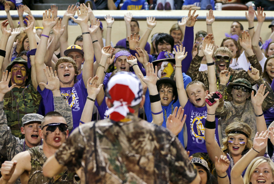 Okarche fans are led in a cheer during Saturday�s game. Photo by Bryan Terry, The Oklahoman