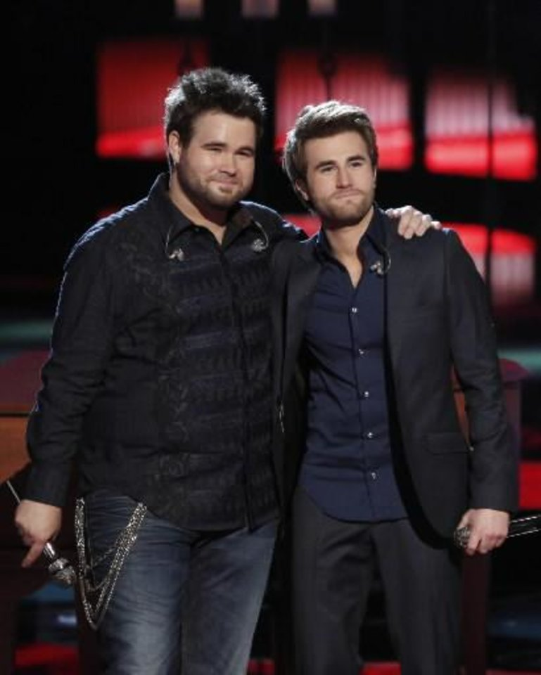 "Photo -  This June 17, 2013 image released by NBC shows Muskogee duo Zach Swon, left, and Colton Swon of The Swon Brothers, on stage during the singing competition series ""The Voice,"" in Los Angeles. The Swon Brothers finished third to runner-up Michelle Chamuel and winnner Danielle Bradbery in the finale on Tuesday."