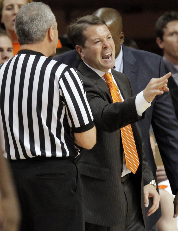 Photo - OSU head coach Travis Ford reacts after a call in the first half during the men's college basketball game between Nicholls State University and Oklahoma State University at Gallagher-Iba Arena in Stillwater, Okla., Saturday, Nov. 21, 2010. Photo by Nate Billings, The Oklahoman