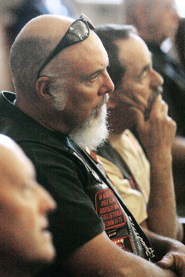 Photo - Vietnam war veterans Mike Manning, Yukon, and Dan Cross, Okla. City, listen to the judge during the bond hearing for Jerome Ersland at the Oklahoma County Courthouse in Oklahoma City Thursday, May 28, 2009. Photo by Paul B. Southerland, The Oklahoman