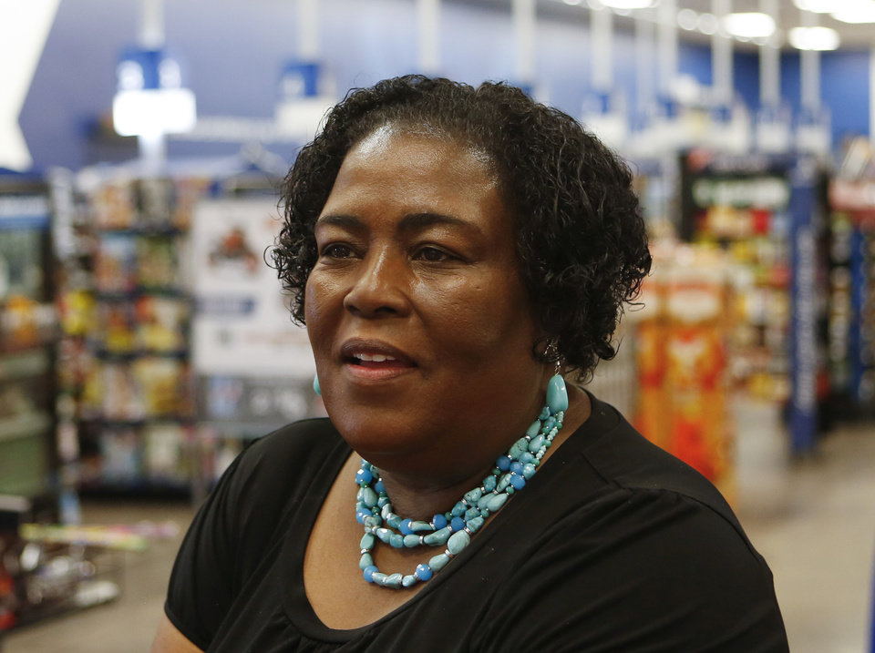 Photo -  Wanda Holmes, a wife a retired member of the Air Force, said shopping at the Commissary and the Exchange is helpful now that they she and her are retired because she can get more for less. [Photo by Jacob Derichsweiler, The Oklahoman]