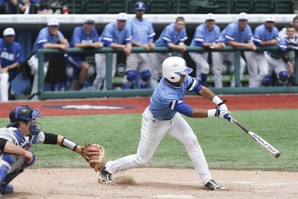 Photo - Seton Hall's Derek Jenkins hits a single to score a run in the sixth inning of a NCAA college baseball game against Creighton in the Big East Conference tournament, Saturday, May 24, 2014, in New York. Creighton won 2-1. (AP Photo/John Minchillo)