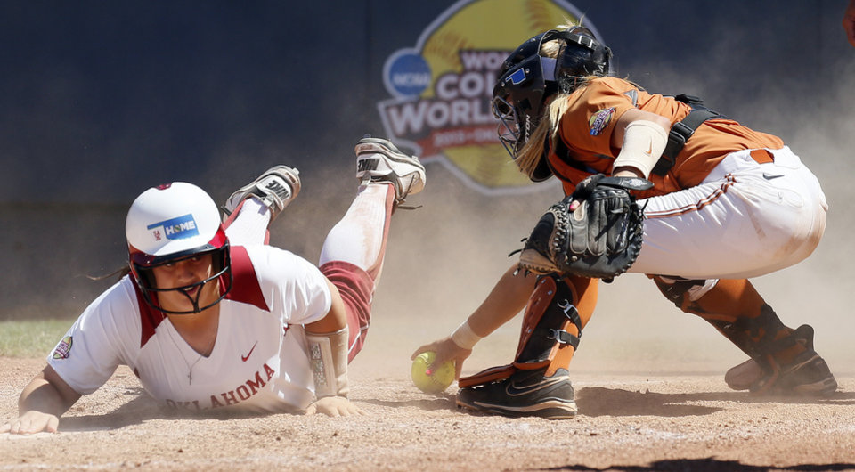 Photo - OU's Brittany Williams (23) reaches back to make sure she touched home plate as Texas catcher Mandy Ogle (5) grabs the ball in the third inning during an NCAA softball game in the Women's College World Series between Oklahoma and Texas at ASA Hall of Fame Stadium in Oklahoma City, Saturday, June 1, 2013. Oklahoma won 10-2 in five innings. Photo by Nate Billings, The Oklahoman