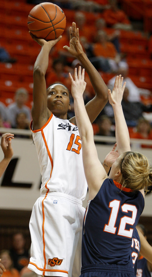 OSU's Toni Young (15) takes a shot beside Pepperdine's Skye Barnett (15)during a first-round NIT women's college basketball game between Oklahoma State University (OSU) and Pepperdine at Gallagher-Iba Arena in Stillwater, Okla., Wednesday, March 16, 2011. Photo by Bryan Terry, The Oklahoman