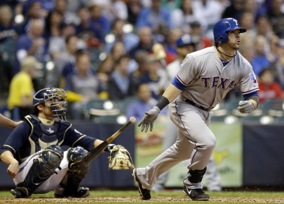 Photo - Texas Rangers' Mitch Moreland followed through on his home run during the third inning of a baseball game against the Milwaukee Brewers Wednesday, May 8, 2013, in Milwaukee. (AP Photo/Morry Gash)