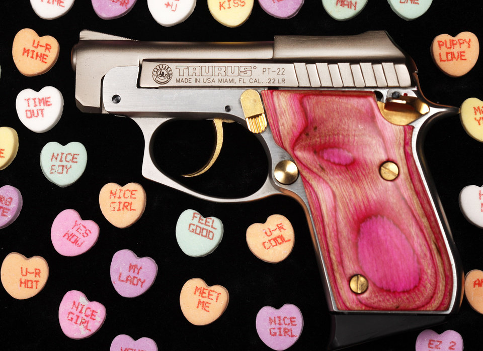 Photo - Left: A pink Taurus PT-22 pistol at Big Boy's Guns and Ammo in Oklahoma City. Photos by Steve Gooch,  The Oklahoman