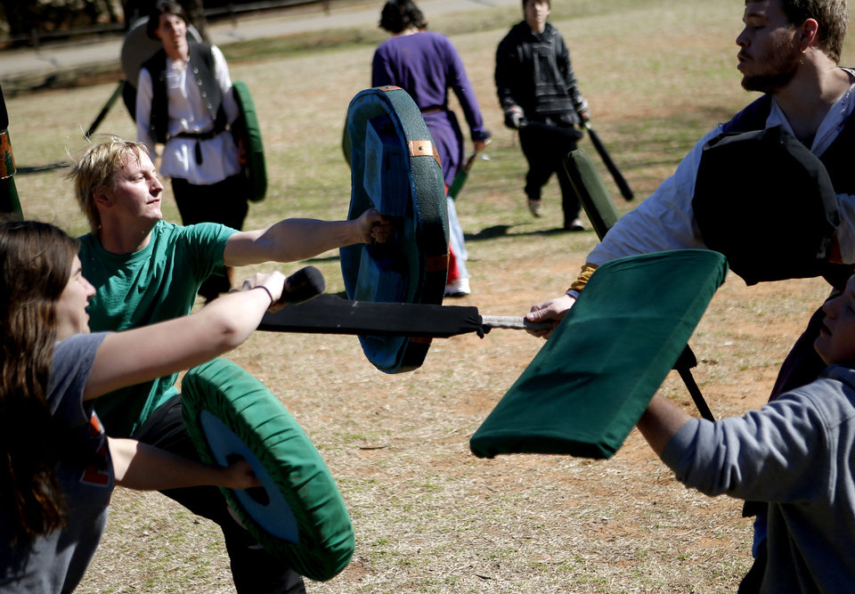 Photo - Shaun Anderson, left, fights as he practices Dagorhir battle games at E.C. Hafer Park. A group of Dagorhir players meet on Saturdays in the park.  PHOTO BY BRYAN TERRY, THE OKLAHOMAN.  BRYN TERRY - THE OKLAHOMAN