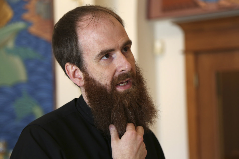 Photo - Father Jeremy Davis, associate priest at St. Elijah Antiochian Orthodox Christian Church in Oklahoma City.  Photo by Garett Fisbeck, The Oklahoman  Garett Fisbeck - Garett Fisbeck