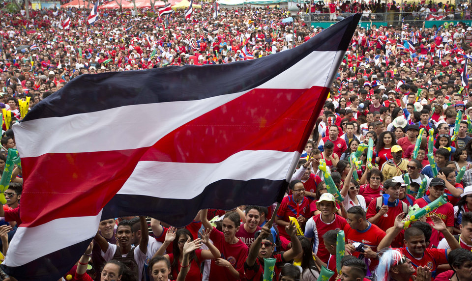 Photo - Costa Rica soccer fans gather to watch their team's World Cup round of 16 match against Greece on TV set up in a public square in San Jose, Costa Rica, Sunday, June 29, 2014. (AP Photo/Esteban Felix)