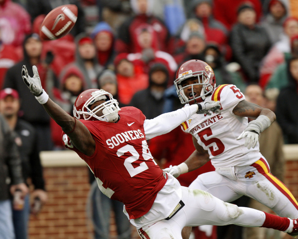 Photo - Oklahoma's Dejuan Miller (24) can't make the catch in front of Iowa State's Jeremy Reeves (5) during a college football game between the University of Oklahoma Sooners (OU) and the Iowa State University Cyclones (ISU) at Gaylord Family-Oklahoma Memorial Stadium in Norman, Okla., Saturday, Nov. 26, 2011. Photo by Bryan Terry, The Oklahoman