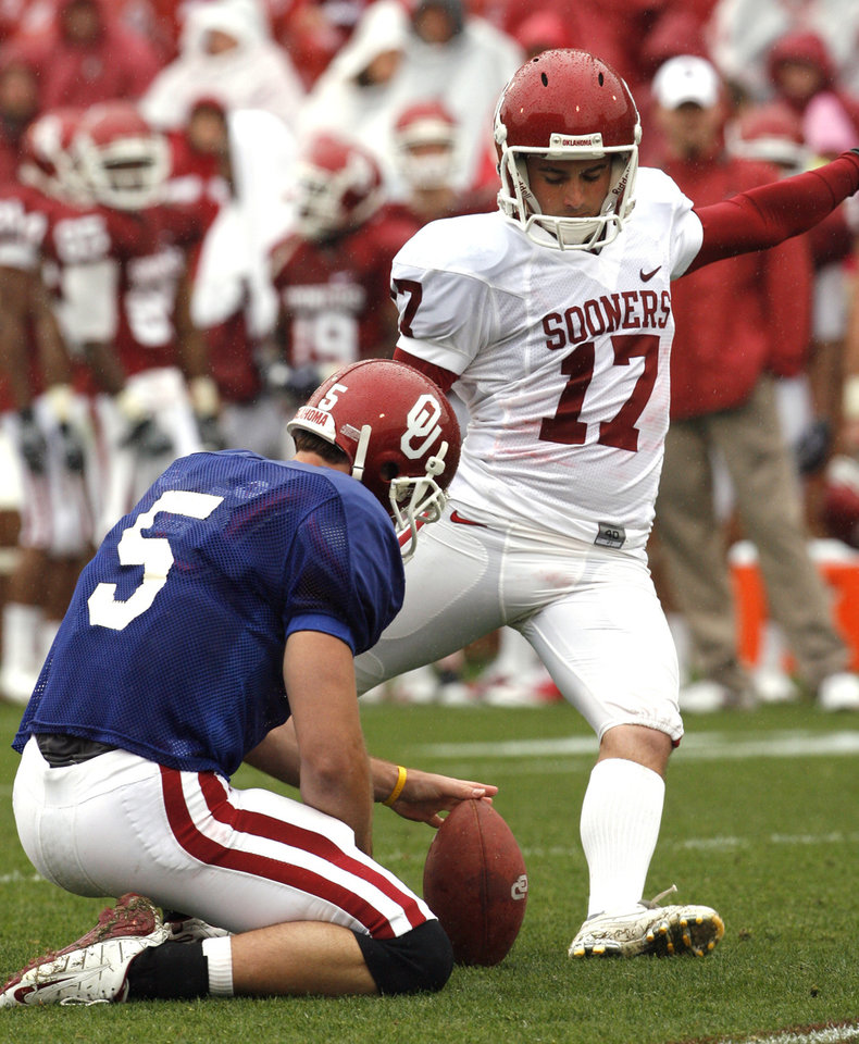 Photo - Jimmy Stevens (17) kicks from the hold of John Nimmo (5) during the spring Red and White football game for the University of Oklahoma (OU) Sooners at Gaylord Family/Oklahoma Memorial Stadium on Saturday, April 17, 2010, in Norman, Okla.  Photo by Steve Sisney, The Oklahoman