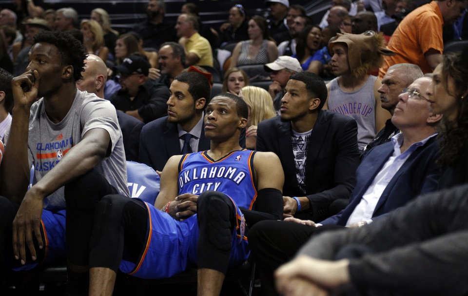 Photo - Oklahoma City's Russell Westbrook (0) sits on the bench in the final minutes during Game 5 of the Western Conference Finals in the NBA playoffs between the Oklahoma City Thunder and the San Antonio Spurs at the AT&T Center in San Antonio, Thursday, May 29, 2014. Photo by Sarah Phipps, The Oklahoman