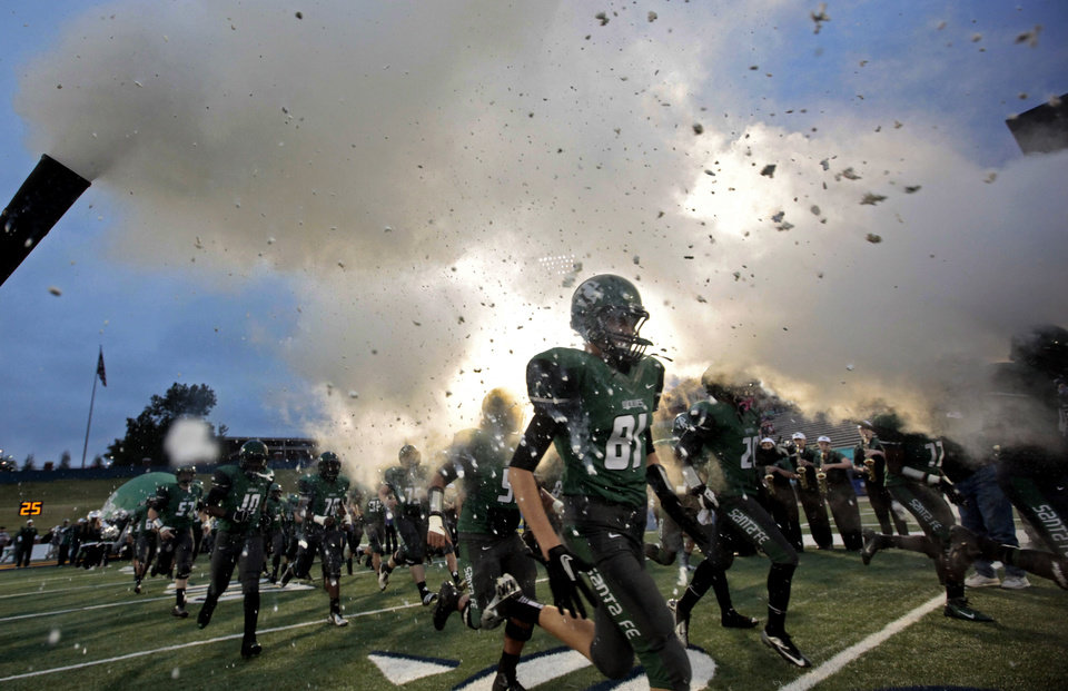 Photo - Edmond Santa Fe's Camron Jourdan runs onto the field during high school football game between Edmond Santa Fe and Edmond North at Wantland Stadium in Edmond, Okla.,  Wednesday, Jan. 23, 2008. Photo by Sarah Phipps, The Oklahoman