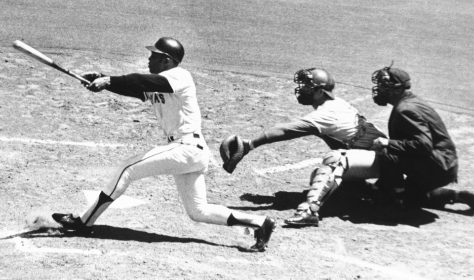 Photo - FILE - In this July 18, 1970, file photo, San Francisco Giants's Willie Mays connects with the 3,000th hit of his career, a single to left, in the second inning against the Montreal Expos at Candlestick Park in San Francisco. Expos catcher John Bateman waits for pitch from teammate Mike Wegener. The umpire is Mel Steiner. Candlestick Park, known for its bone-numbing winds, the Catch and the earthquake-rocked 1989 World Series. is officially closing after more than a half century of hosting sporting and cultural events. In a bow to historical symmetry, the Stick's finale will be a performance Thursday by Paul McCartney, 48 years after the Beatles' last scheduled concert lit up the venue. (AP Photo/Robert H. Houston, File)