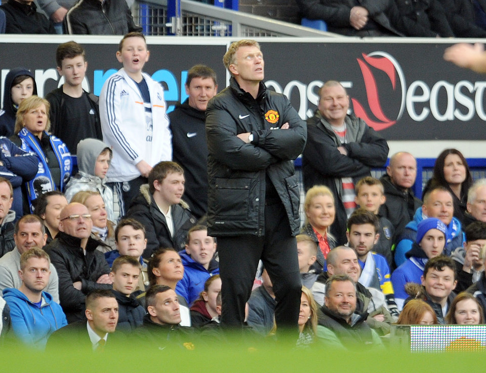 Photo - Manchester United's manager David Moyes is seen during their English Premier League soccer match against Everton at Goodison Park in Liverpool, England, Sunday April 20, 2014. (AP Photo/Clint Hughes)
